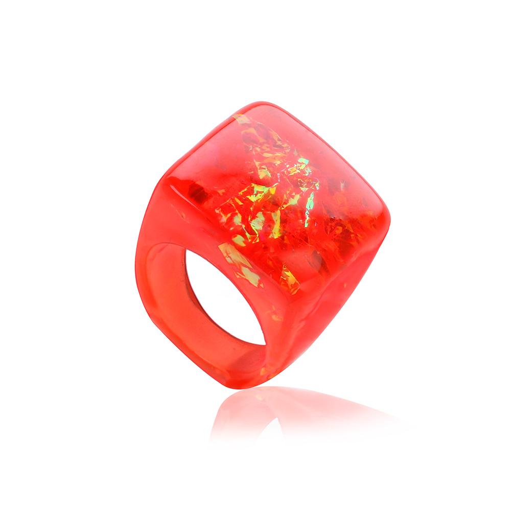 inel roșu din rășină cu reflexii arămii și culoare roșu granat și roșu de rubin, bijuterie unicat